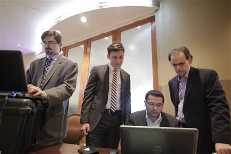 Handout of Microsoft staff and forensics experts examining evidence related to the Citadel malware that was collected from a New Jersey data center in Atlantic City