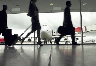 People walking through airport, silhouette (focus on aeroplane)